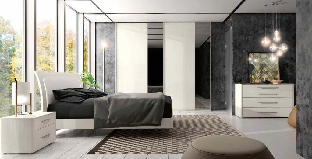 camera da letto moderna con letto , comò e comodino arredamenti divani torino