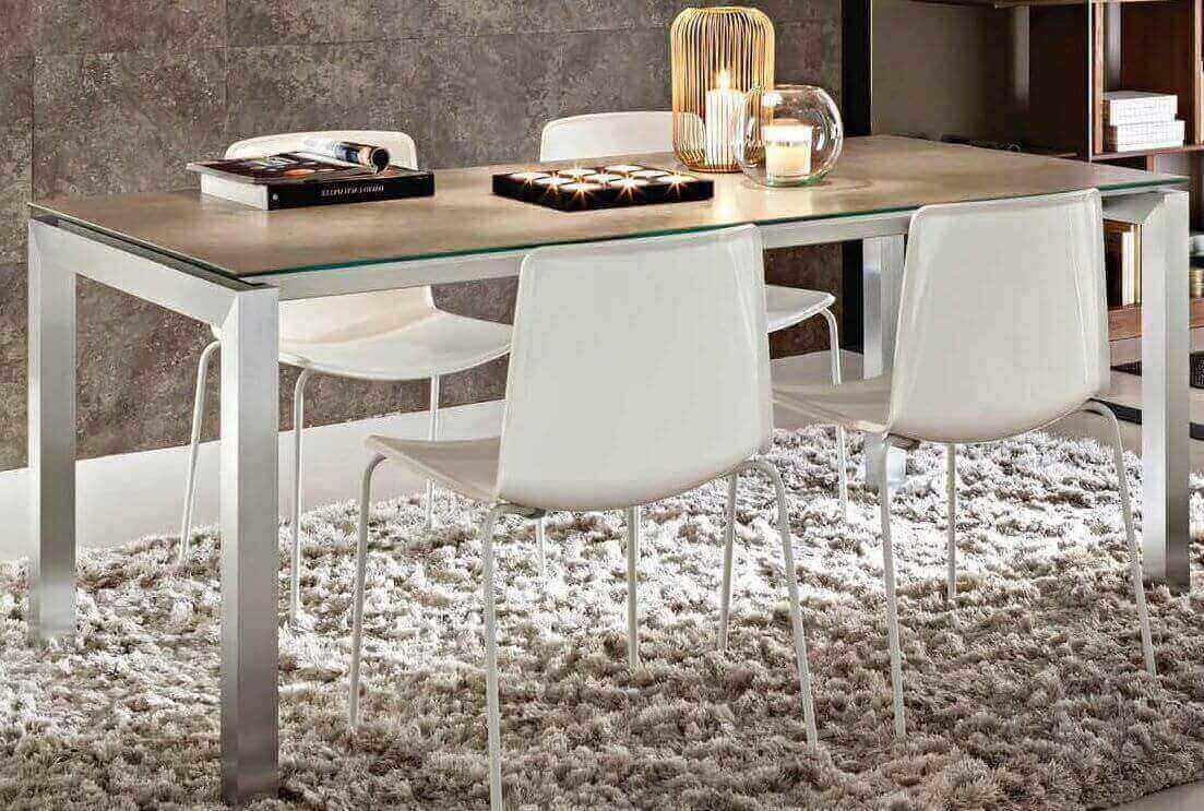 Tavolo allungabile con struttura in alluminio arredamenti divani torino